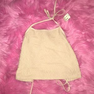 Pale yellow backless halter top